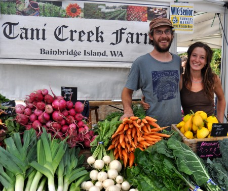 Max (left) and Ali from Tani Creek Farm at Madrona Farmers Market. Copyright Zachary D. Lyons.